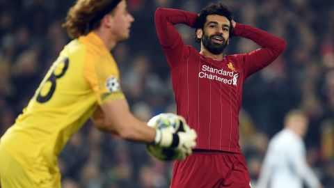 Liverpool's Egyptian midfielder Mohamed Salah (C) reacts as RC Genk's Belgian goalkeeper Gaetan Coucke collects the ball during the UEFA Champions League group E football match between Liverpool and RC Genk at Anfield in Liverpool, north west England on November 5, 2019. (Photo by Oli SCARFF / AFP) (Photo by OLI SCARFF/AFP via Getty Images)