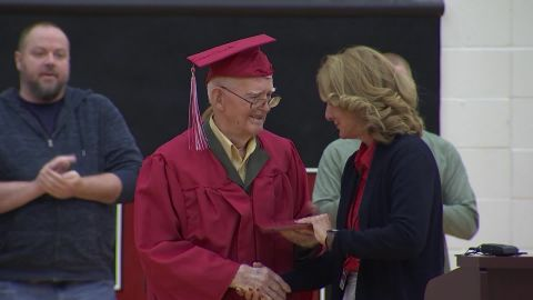 Lewie Shaw receives his diploma on Thursday from Claremore High School Principal Kerri Garroutte.