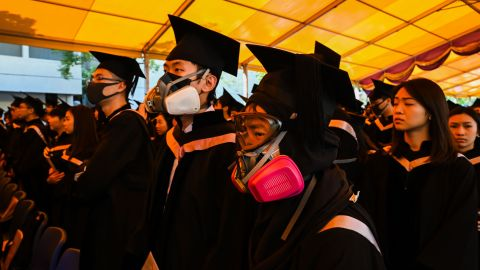 Students in gas masks are seen during a graduation ceremony at the Chinese University of Hong Kong on Thursday, November 7 in Hong Kong.