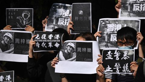 """Students of the Hong Kong University of Science and Technology (HKUST) participate in a march on November 8, after hospital officials confirmed the <a href=""""https://edition.cnn.com/2019/11/07/asia/hong-kong-protester-death-intl-hnk/index.html"""" target=""""_blank"""">death of student Chow Tsz-lok</a>, 22. Police say Chow, a computer sciences student at HKUST, fell from the third floor to the second floor of a parking garage in the residential area of Tseung Kwan O in the early hours of November 4."""