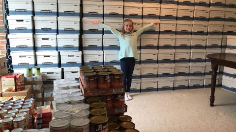 Alex poses in front of her 2017 Thanksgiving mission results.
