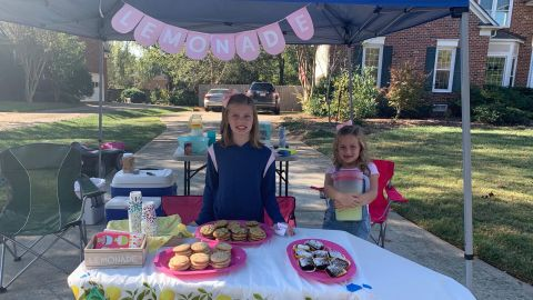 Alex, left, and Caroline made $969 in cash from their lemonade stand this year. They raised almost $2,000 additional funds through donations.