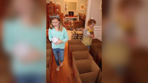 Alex Fischer, left, and her sister Caroline raised nearly $3,000 to provide Thanksgiving meals to families in need.