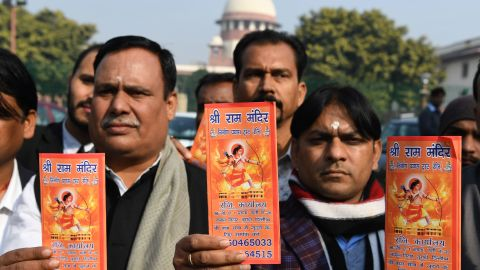 Indian Hindu protesters hold leaflets with the picture of Lord Ram outside the Indian Supreme Court in New Delhi on January 10, 2019.