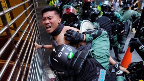 A protester is detained in the Central District of Hong Kong on November 11.