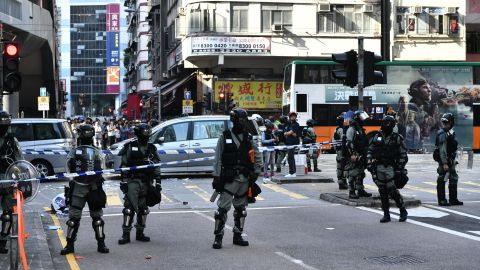 Police officers cordon off an area where pro-democracy protesters were shots by a policeman in Hong Kong on November 11, 2019. - A Hong Kong police officer shot at masked protesters -- hitting at least one in the torso -- during clashes broadcast live on Facebook, as the city's rush hour was interrupted by protests. (Photo by Anthony WALLACE / AFP) (Photo by ANTHONY WALLACE/AFP via Getty Images)
