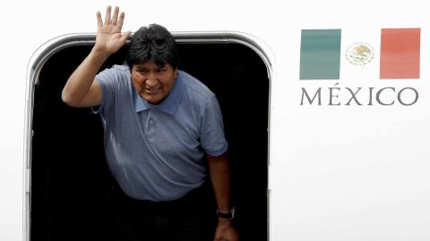 Former Bolivian President Evo Morales waves upon his arrival in Mexico City on Tuesday.
