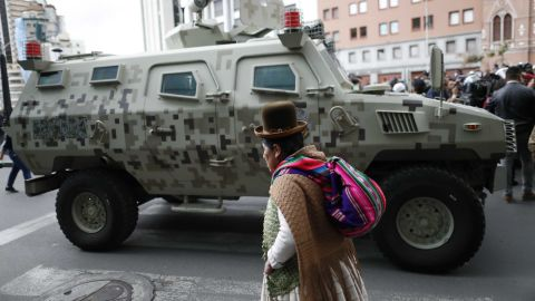 A military armored vehicle patrols as supporters of former President Morales march in La Paz.