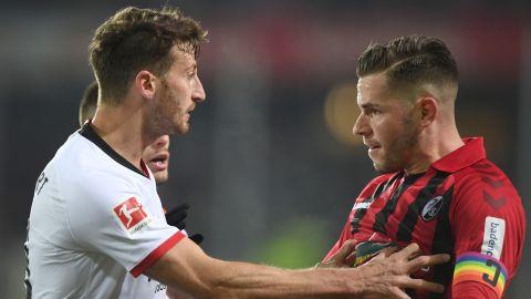 Abraham pushes Freiburg's defender Christian Guenter.