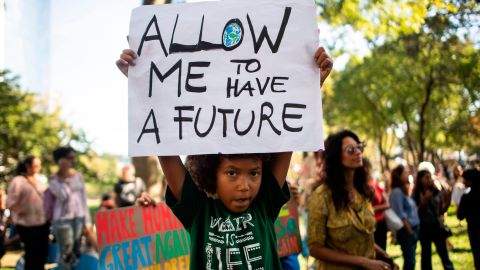 Students participate in the Global Climate Strike march on September 20, 2019 in New York City. - Crowds of children skipped school to join a global strike against climate change, heeding the rallying cry of teen activist Greta Thunberg and demanding adults act to stop environmental disaster. It was expected to be the biggest protest ever against the threat posed to the planet by climate change. (Photo by Johannes EISELE / AFP)        (Photo credit should read JOHANNES EISELE/AFP via Getty Images)