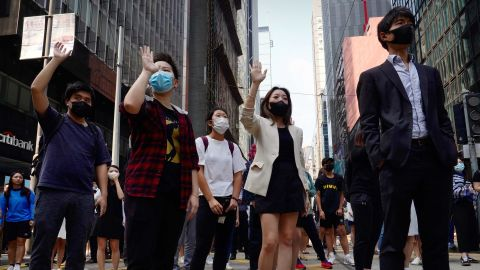 Demonstrators gather during a lunchtime protest in the financial district of Hong Kong on November 14.