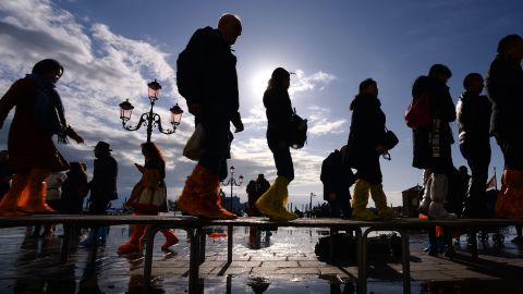 People walk across a footbridge on Riva degli Schiavoni on November 14, 2019 in Venice.