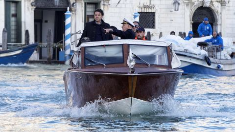 Italian Prime Minister Giuseppe Conte on a boat as he visits the flood-affected city of Venice on November 14, 2019.