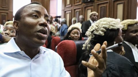 """Convener of """"#Revolution Now"""" Omoyele Sowore speaks during his arraignment for charges against the government at the Federal High Court in Abuja, on September 30, 2019. - Nigeria's high court ordered on September 30, 2019,  a former presidential candidate remanded in custody after he was charged with plotting treason over calls for a """"revolution"""" in the West African nation.Omoyele Sowore, a fierce critic of President Muhammadu Buhari, has been held since August by the Department of State Services (DSS) secret police after urging protests under the online banner """"#RevolutionNow"""". (Photo by KOLA SULAIMON / AFP)        (Photo credit should read KOLA SULAIMON/AFP via Getty Images)"""