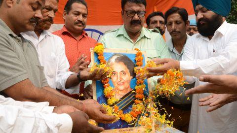 Men pay tribute to former Indian Prime Minister Indira Gandhi, in Amritsar on October 30, 2019.