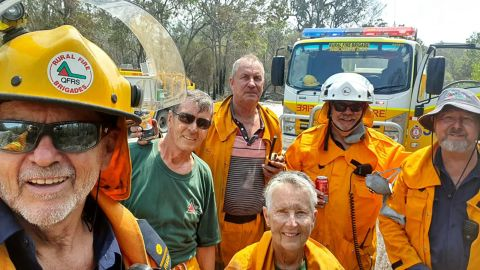 John Foster (left) and a team of volunteers from the Woodgate Rural Fire Brigade are battling a bushfire in Queensland.