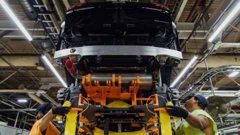 """FCA US employees use skillets to """"marry"""" the chassis to the body of a Jeep Cherokee at the Belvidere (Ill.) Assembly Plant. A skillet looks like the bellows of an accordion on its side and carries the vehicle down the line, adjusting in height from 13 inches to up to 52 inches. Belvidere Assembly began production of the Jeep Cherokee on June 1, 2017, after it moved from the Toledo (Ohio) Assembly Complex as part of the Company's plan to increase manufacturing capacity of trucks and SUVs.  (2017)"""