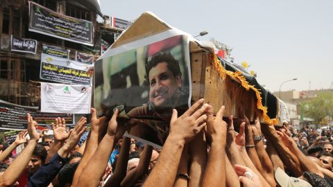 Mourners carry the coffin of an Iraqi man who was among nearly 300 people killed in an ISIS suicide bombing that ripped through Baghdad's busy shopping district of Karrada in July 2016.