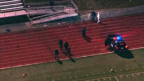 Police respond to a reported shooting at a high school football game in Pleasantville, New Jersey.