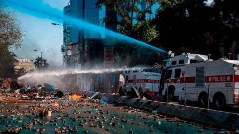 Police use a water cannon outside the Hong Kong Polytechnic University.