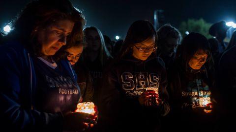 Yvonne Pane, Danielle Pane, Anh-Thi Ta and Ha Trinh pray at a vigil for the shooting victims.