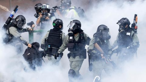 """Police in riot gear move through a cloud of smoke as they detain a protester at the Hong Kong Polytechnic University in Hong Kong on November 18. Police have <a href=""""https://edition.cnn.com/asia/live-news/hong-kong-protests-live-nov-18-intl-hnk/index.html"""" target=""""_blank"""">attempted to clear the university</a>, which has been occupied by protesters for days as a strategic protest base."""