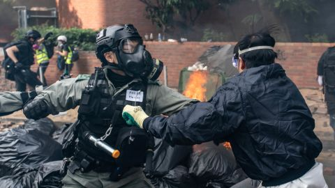 A member of the police clashes with a protester at the Hong Kong Poytechnic University on November 18.