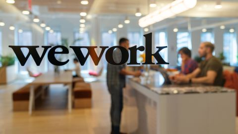 Signage is seen at the entrance of the WeWork Cos Inc. 85 Broad Street offices in the Manhattan borough of New York, U.S., on Wednesday, May 22, 2019. WeWork has become the biggest private office tenant in London,Manhattanand Washingtonon its way to425 office locations in 36 countries overall. Photographer: David 'Dee' Delgado/Bloomberg via Getty Images
