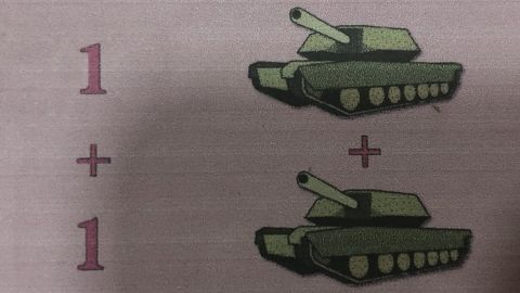 A schoolbook shows how tanks were used in an arithmetic lesson.