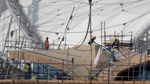 Workers are pictured on scaffolding at the Khalifa International Stadium in Doha.