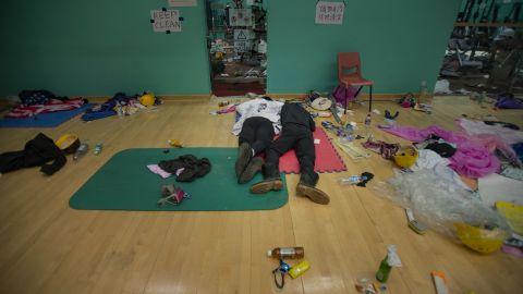 Protesters sleep inside the gymnasium.