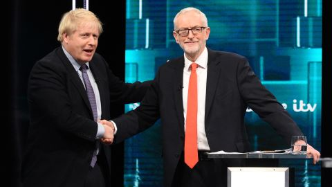 SALFORD, ENGLAND - NOVEMBER 19: (AVAILABLE FOR EDITORIAL USE UNTIL DECEMBER 19, 2019) In this handout image supplied by ITV, Prime Minister Boris Johnson and Leader of the Labour Party Jeremy Corbyn shake hands during the ITV Leaders Debate at Media Centre on November 19, 2019 in Salford, England. This evening ITV hosted the first televised head-to-head Leader's debate of this election campaign. Leader of the Labour party, Jeremy Corbyn faced Conservative party leader, Boris Johnson after the SNP and Liberal Democrats lost a court battle to be included. (Photo by Jonathan Hordle//ITV via Getty Images)