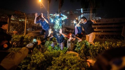 """Police detain a group of people after they tried to flee the Hong Kong Polytechnic University campus on November 19. Last week, thousands of student protesters streamed into the <a href=""""https://www.cnn.com/2019/11/19/asia/hong-kong-polytechnic-university-scene-intl-hnk/index.html"""" target=""""_blank"""">university and occupied the campus </a>as the city's violent political unrest reached fever pitch."""