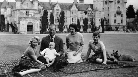 Prince Andrew sits on his father's lap during a holiday in Scotland in September 1960. At left is his sister, Princess Anne. At right, next to the Queen, is his brother Prince Charles.
