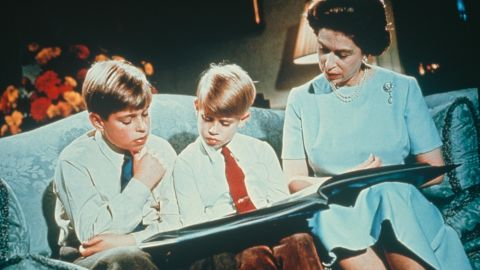 The Queen looks at a photo album with Andrew, left, and Edward in 1971.