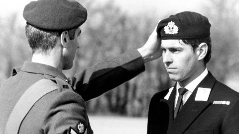 Prince Andrew receives a Green Beret award at an event in 1980. He served in the British Royal Navy for 22 years and was a helicopter pilot during the Falklands War.