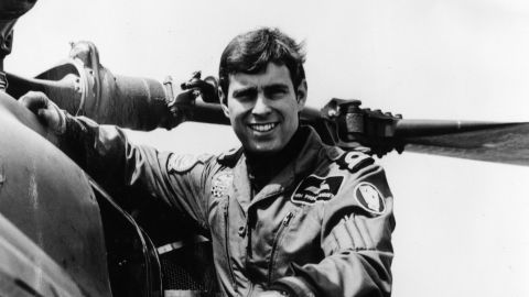 Prince Andrew poses next to a helicopter in 1982.