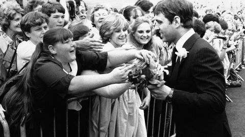 Girls line up to give flowers to Prince Andrew as he arrives in Portsmouth, England, for an event in 1983.