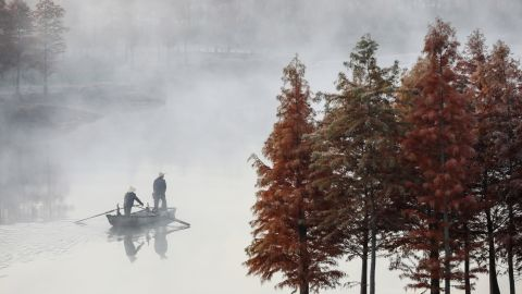 <strong>Xuyi County, China:</strong> in China's eastern Jiangsu province, a boat moves through the November fog on Tianqin Lake. <br />