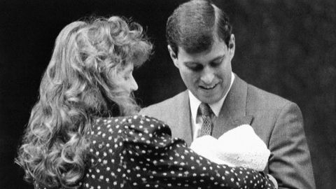 The couple holds their first child, Beatrice, in 1988. They had two children together before their high-profile divorce in 1996.