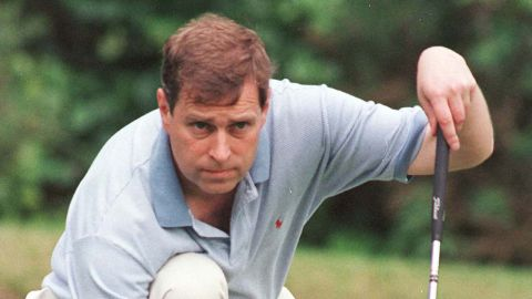 The prince lines up a putt during a celebrity golf tournament in 1998.