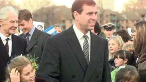 Prince Andrew holds hands with his two daughters, Beatrice and Eugenie, after arriving for a dinner in London in 1997.