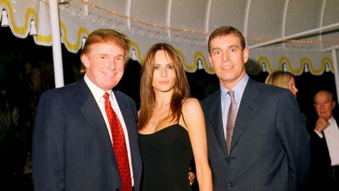 Prince Andrew poses with Donald Trump and Trump's future wife, Melania, at the Mar-a-Lago estate in Palm Beach, Florida, in 2000.