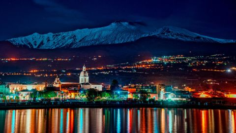 <strong>Catania, Italy: </strong>The snow-capped peak of active volcano Mount Etna is seen from the port of Riposto in Catania, Sicily. <br />