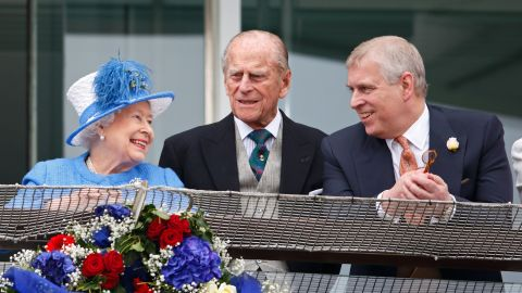 Prince Andrew and his parents watch horse racing in Epsom, England, in 2016.