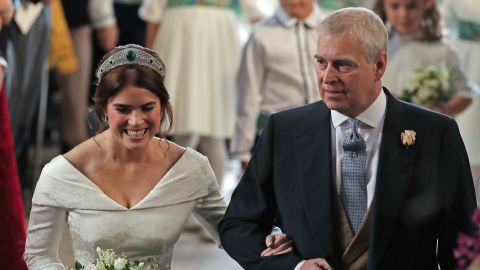 Princess Eugenie is accompanied by her father during her wedding in 2018.