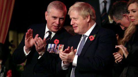 Prince Andrew talks with British Prime Minister Boris Johnson at the annual Royal British Legion Festival of Remembrance, which took place in London in November 2019.
