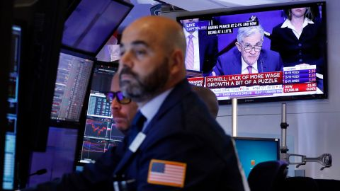 A television screen on the floor of the New York Stock Exchange shows Federal Reserve Chair Jerome Powell testifying in Washington, Wednesday, Nov. 13, 2019. (AP Photo/Richard Drew)