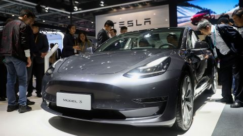People view a Tesla Model 3 at the Automobile exhibition area during the second China International Import Expo  in Shanghai, east China, Nov. 6, 2019. The National Exhibition and Convention Center in Shanghai greeted a large number of visitors on the second day of the CIIE.