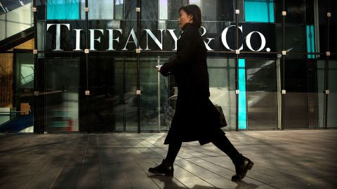 In this Thursday, Nov. 29, 2018, photo, a woman walks past a Tiffany & Co. store at a shopping mall in Beijing.